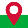 A red mapping pin. A green background covers the bottom half of the image with white above (mimicking the flag of Wales)