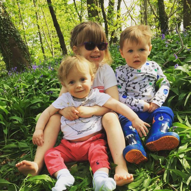 3 kids in a bluebell woodland