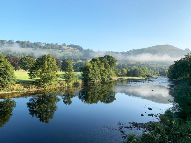 Early morning mist over river